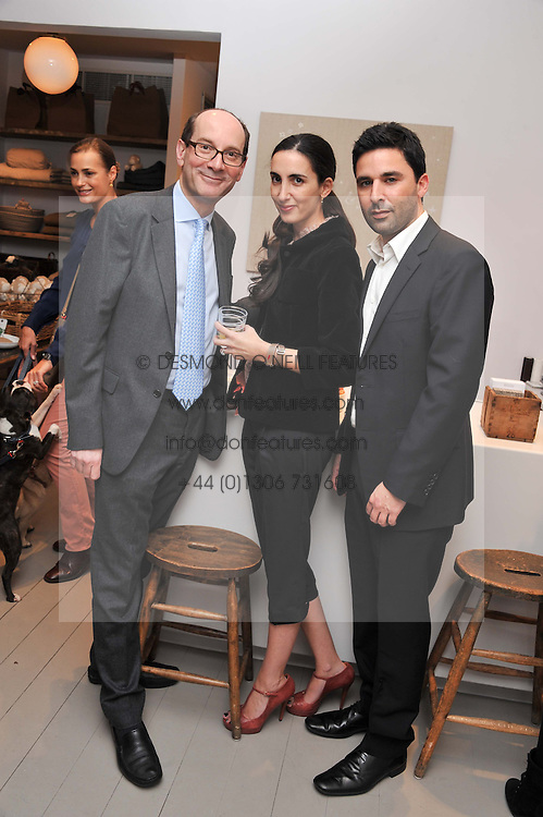 Left to right, MICHAEL & NICOLA SACHER and  JONATHAN ZATLAND at a party at Mungo & Maud, 79 Elizabeth Street, London to celebrate the launch of a collection of dog accessories designed by Yasmin Le Bon held on 22nd November 2011.