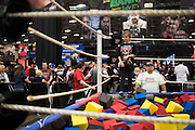 Fans enjoy WWE Axxess ahead of WrestleMania on April 1, 2016 in Dallas, Texas.