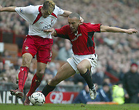 Photo. Andrew Unwin.<br /> Manchester United v Southampton, Barclaycard Premier League, Old Trafford, Manchester 31/01/2004.<br /> Southampton's James Beattie (l) battles with Manchester United's Mikael Silvestre (r).