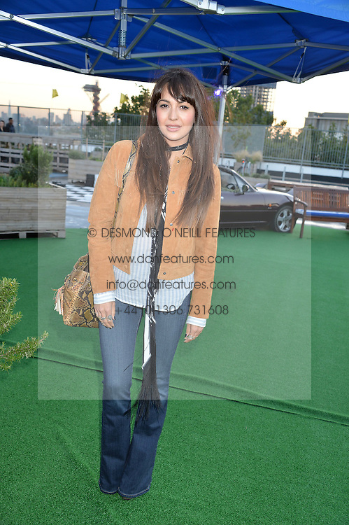ZARA MARTIN at the launch of the Orangina Boulers Rooftop Petanque held on the top floor of the Stratford Multistorey Car Park, Great Eastern Way, London E15 on 26th August 2015.