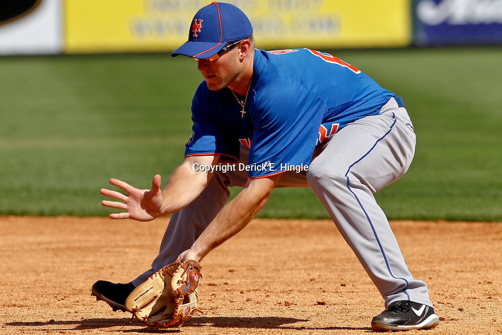 March 14, 2012; Lakeland, FL, USA; New York Mets second baseman Lucas May (62) warms up before a spring training game against the Detroit Tigers at Joker Marchant Stadium. Mandatory Credit: Derick E. Hingle-US PRESSWIRE