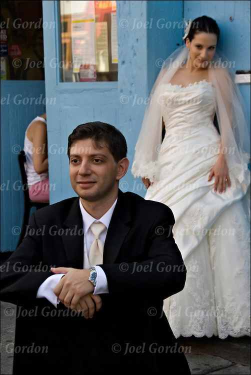 Bride and Groom possing for photographer before the wedding