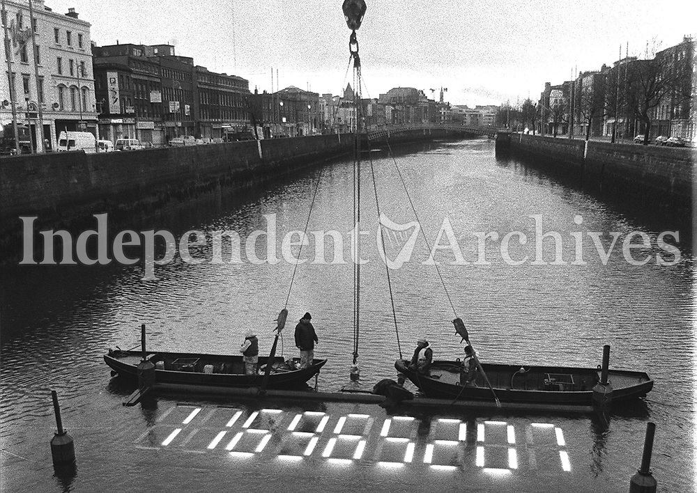The Millenium Clock being restored on the River Liffey after repair work had been carried out, April 1996. (Part of the Independent Newspapers Ireland/NLI Collection)
