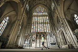 Lead Labourer Andy Bracegirdle walks past the 600-year old Great East Window in York Minster, as work is completed in a decade-long project to conserve and restore the largest expanse of medieval stained glass in the country.