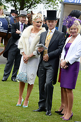 Left & centre, JEREMY KYLE and his wife CARLA at the Investec Derby 2013 held at Epsom Racecourse, Epsom, Surrey on 1st June 2013.