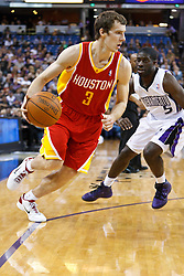 March 7, 2011; Sacramento, CA, USA;  Houston Rockets point guard Goran Dragic (3) dribbles past Sacramento Kings point guard Pooh Jeter (5) during the second quarter at the Power Balance Pavilion.