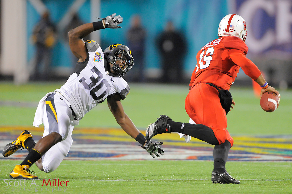 West Virginia Mountaineers linebacker J.T. Thomas (30) in action during the Mountaineers 23-7 loss to the North Carolina State Wolfpack in the 2010 Champs Sports Bowl at the Florida Citrus Bowl on Dec. 28, 2010 in Orlando, Florida... ©2010 Scott A. Miller