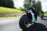 Bike to the future! Slick electric motorcycle cruises 125 miles on just one charge<br /> <br /> The uptake of electric vehicles is usually limited by how far they can travel on a single charge, with experts even coining a new term to describe the feeling of uncertainty over whether you have enough power to reach your destination; 'range anxiety'.<br /> <br /> Now one Austrian company is hoping to tackle the problem with the introduction of the Johammer J1 - an electric bike that can travel 125 miles (200km) on a single charge.<br /> <br /> Created by Bad Leonfelden-based group Johammer, the electric bike has an almost silent motor integrated into the rear wheel.<br /> <br /> The 11 kilowatt hub-mounted motor provides 14 horsepower and a top speed of 74mph (119kph).<br /> <br /> Electric hub-mounted motors contain the electric motor within the wheel hub, or central part of the wheel.<br /> <br /> To drive the wheel, the motor contains a coil which generates an electromagnetic field as power flows through it.<br /> <br /> The field attracts the outer part of the motor, which attempts to follow its direction, and in doing so turns the connected wheel.<br /> <br /> The hub motors eliminates the need for a heavy transmission, gear train, and axles which reduces the weight, making the electric bike far more efficient.<br /> <br /> In place of traditional gauges, the side mirrors have high-resolution displays that show information on the bike's speed and range.<br /> <br /> 'The extreme torsion stiff middle-frame made from aluminium provides space for spring damper and battery pack,' the group writes on their website.<br /> <br /> 'Perfectly balanced (at 350mm mass centre height) the Johammer offers an unmatched and safe driving experience. Steering and footpeg allow for individual adaptation.'<br /> <br /> The bike, which can be purchased from the Johammer, currently comes in silver, white, blue, yellow and green options.<br /> <br /> The J1.150 will set you back £19,000 ($31,600) while the J1.200 will hit your wallet a bit harder at £20,600 ($34,500) in exchange for a bigger battery and longer range.<br /> ©Johammer/