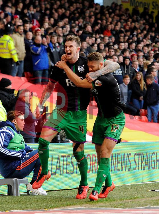 Aden Flint of Bristol City celebrates with Nathan Baker of Bristol City  - Mandatory byline: Joe Meredith/JMP - 27/02/2016 - FOOTBALL - The City Ground - Nottingham, England - Nottingham Forest v Bristol City - Sky Bet Championship
