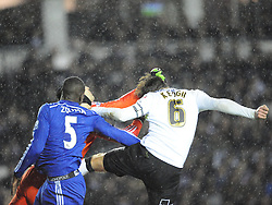 Chelsea Kurt Zouma gets a punch in the jaw from Derby Richard Keogh as he goes for goal, which Zouma needed treatment and taken of on a stretcher, Derby County v Chelsea, Capital One Cup Quarter Final, Score Derby 1(Bryson),  Chelsea 3 (Hazard, Luis, Schurrle) Pride Park Tuesday 16th December 2014