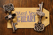 Thank you from the bottom of my heart tag on wedding guest favors -- The vintage key guest favors helped to display the couple's wedding rings