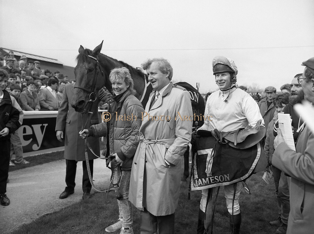 "Irish Grand National At Fairyhouse.  (R54)..1987..20.04.1987..04.20.1987..20th April 1987..The Easter Racing Festival at Fairyhouse included the running of the Jameson sponsored Irish Grand National. Another featured race was the Jameson Gold Cup which was also run on Easter Monday...Image shows Stablegirl,Owner and Winning jockey posing for pictures with the winning horse ""Brittany Boy""in the winner's enclosure, Jameson's, Irish, Whiskey, jameson,"
