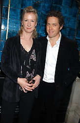HUGH GRANT and JOANNA JOHNSTON at a party hosted by Tanner Krolle held at Leighton House, 12 Holland Park Road, London W14 on 8th December 2005.<br /><br />NON EXCLUSIVE - WORLD RIGHTS