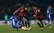 Leon Best, Brighton striker evades Bruno Ecuele Manga during the Sky Bet Championship match between Cardiff City and Brighton and Hove Albion at the Cardiff City Stadium, Cardiff, Wales on 10 February 2015.