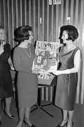 12/02/1964<br /> 02/12/1964<br /> 12 February 1964<br /> Presentations of Richard Hudnut cosmetics to Marie O'Sullivan Telifis Eireann announcer  at the Muckross Fashion Show in the Intercontinental Hotel, Dublin.