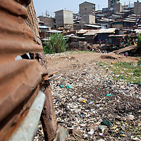 As you pass through the community, tin sheets are the staple of nearly every structure, and open spaces are littered with trash that has no where else to be disposed of.
