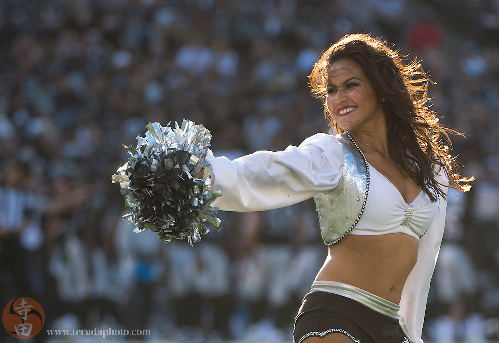 August 30, 2015; Oakland, CA, USA; Oakland Raiders Raiderettes cheerleader Brandi performs during the second quarter in a preseason NFL football game against the Arizona Cardinals at O.co Coliseum. The Cardinals defeated the Raiders 30-23.