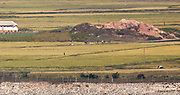 North Korean soldiers working on the road and an ox cart are seen at a village in Kaepung county, North Hwanghae province, North Korea in this picture taken from Ganghwa Peace Observatory of South Korea, about 2 km (1.2 miles) south of North Korean territory, in Ganghwa, 56 km (35 miles) northwest of Seoul, South Korea, October 2, 2017. Photo by Lee Jae-Won (KOREA) www.leejaewonpix.com