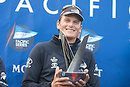NEW ZEALAND, Auckland, 14th February 2009, Louis Vuitton Pacific Series, Dean Barker, Helmsman of Emirates Team NZ lifts the LVPS Trophy.