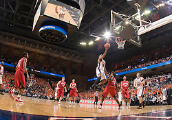 Virginia guard Sean Singletary (44) beats Maryland forward Bambale Osby (50) to score an easy layup.  The Virginia Cavaliers defeated the Maryland Terrapins 91-76 at the University of Virginia's John Paul Jones Arena  in Charlottesville, VA on March 9, 2008.