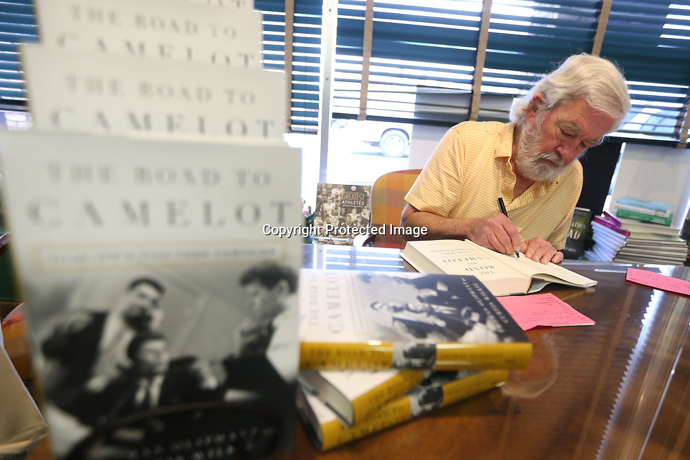 "Author Curtis Wilkie signs copies of his book ""The Road to Camelot"" at Reed's bookstore Thursday in Tupelo."