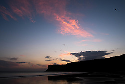 © Licensed to London News Pictures. <br /> 09/10/2014. <br /> <br /> Saltburn, United Kingdom<br /> <br /> Dawn breaks over Huntcliff in Saltburn by the Sea in Cleveland.<br /> <br /> Photo credit : Ian Forsyth/LNP
