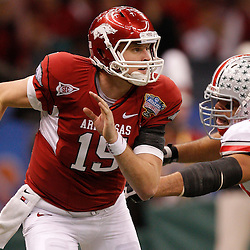 January 4, 2011; New Orleans, LA, USA;  Arkansas Razorbacks quarterback Ryan Mallett (15) is pursued by Ohio State Buckeyes defensive lineman Cameron Heyward (97) during the second quarter of the 2011 Sugar Bowl at the Louisiana Superdome.  Mandatory Credit: Derick E. Hingle