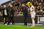 Phil Neville, Head Coach of England FC giving instruction from the sidelines as Lucy Bronze (England) prepares to get the ball back into play during the International Friendly match between England Women and Germany Women at Wembley Stadium, London, England on 9 November 2019.