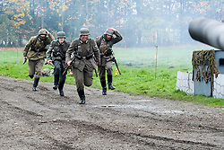 Re-enactors portrayiing panzer grenadiers run to take up positions during a battle battle re-enactment in on Pickering Showground<br /> <br /> 17/18 October 2015<br />  Image &copy; Paul David Drabble <br />  www.pauldaviddrabble.co.uk