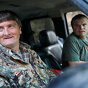 Richard Davidson and Chris Davidson stopped to talk to visitors on their way to hunting squirrels in Wild Cat, Ky., on 3/19/10. Photos by David Stephenson