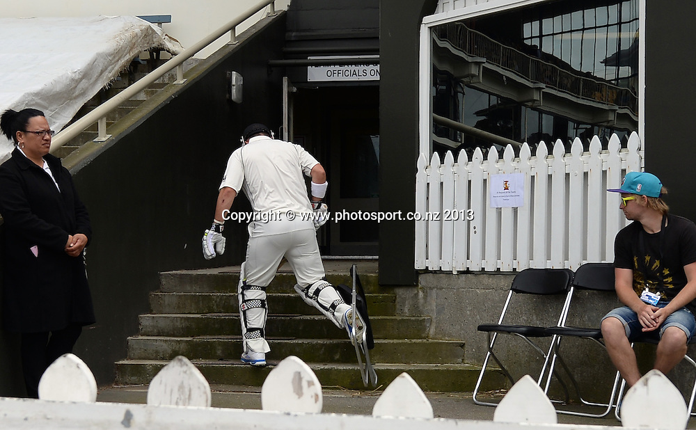 Hamish Rutherford tangles with a chair as he heads back to the dressing room on Day 1 of the 2nd cricket test match of the ANZ Test Series. New Zealand Black Caps v West Indies at The Basin Reserve in Wellington. Wednesday 11 December 2013. Mandatory Photo Credit: Andrew Cornaga www.Photosport.co.nz