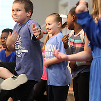 """Griffin Brashier, a second grader at Lawhon Elementary School plays the air guitar with his classmates to """"We Will Rock You"""" by Queen on Friday during test pep rally in preparation for upcoming state testing."""