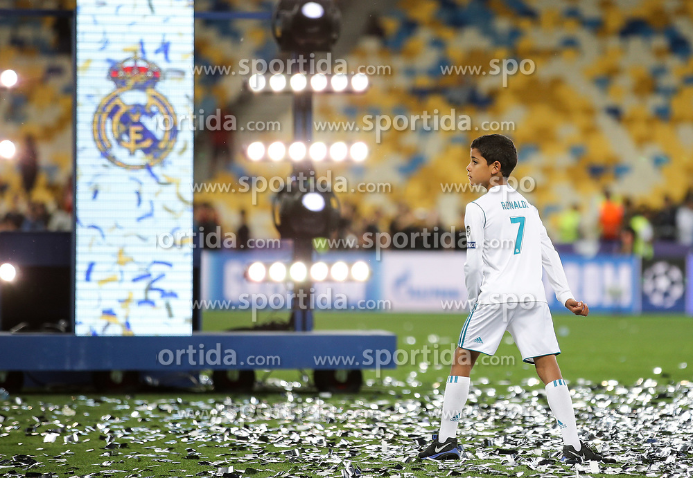 Cristiano Jr, Son of Cristiano Ronaldo of Real Madrid at pitch after Real won 3-1 during the UEFA Champions League final football match between Liverpool and Real Madrid and became Champions League  2018 Champions third time in a row at the Olympic Stadium in Kiev, Ukraine on May 26, 2018.Photo by Andriy Yurchak / Sportida
