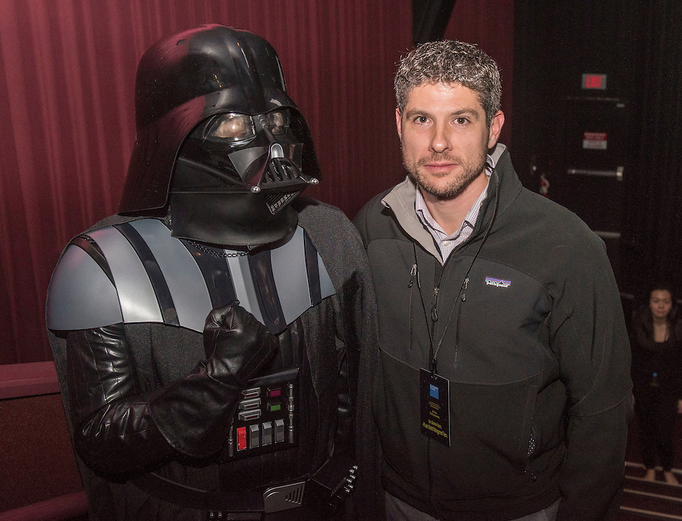December 17, 2015, Boston, MA:<br /> A guest poses for a photograph with Darth Vader during an advanced screening of 'Star Wars: The Force Awakens' for Goldman Sachs at Loews Theatre in Boston, Massachusetts Thursday, December 17, 2015.<br /> (Photo by Billie Weiss/Goldman Sachs)