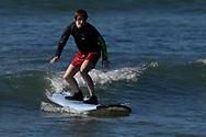Oskar Sunding, on a surf board, Maui, Hawaii.