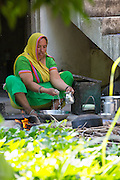 Prabhaben preparing lunch at their home in Ahmedabad, India.<br /> <br /> They have recently installed some drip irrigation on their farm and they are seeing some real improvements in their cotton plants but they are also saving water and time.