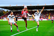 Port Vale's Remie Streete, Exeter City's Jamie Reid and Port Vale's Ben Purkiss during the The FA Cup match between Exeter City and Port Vale at St James' Park, Exeter, England on 6 December 2015. Photo by Graham Hunt.