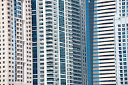 Abstract architecture background of residential apartment tower blocks at Dubai Marina. Close up showing pattern made by windows and balconies.