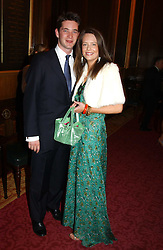 The HON.JAMES TOLLEMACHE and ARABELLA MUSGRAVE at a fashion show and dinner hosted by Shangri-la Hotels and Resorts and Andy Wong featuring fashion by new designer Lu Kun held at The Goldsmiths Hall, Foster Lane, London on 25th April 2005.<br />