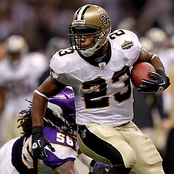 September 9, 2010; New Orleans, LA, USA;  New Orleans Saints running back Pierre Thomas (23)  runs away from Minnesota Vikings linebacker E.J. Henderson (56) during the NFL Kickoff season opener at the Louisiana Superdome. The New Orleans Saints defeated the Minnesota Vikings 14-9.  Mandatory Credit: Derick E. Hingle