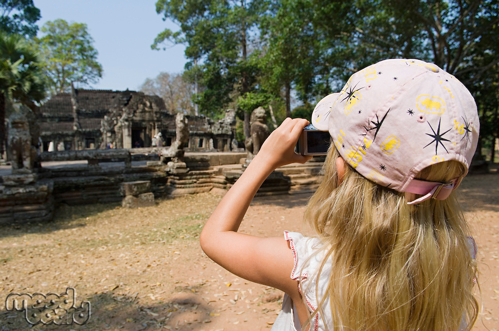 Little Girl Photographing Ancient Temple