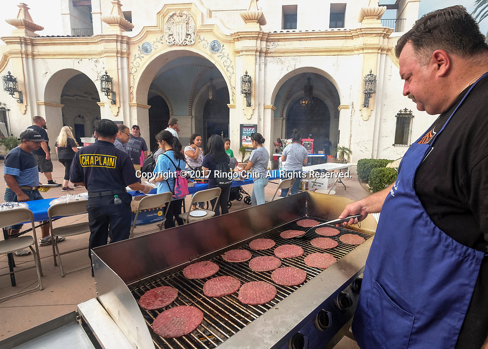 A chef prepares free food for the participants during National Night Out in San Gabriel, California, on Tuesday, Aug. 1, 2017. National Night Out is a community-police awareness-raising event in the United States and Canada, held the first Tuesday of August. Texas and Florida have the option to use the alternate date of the first Tuesday in October to avoid hot weather.(Photo by Ringo Chiu)<br /> <br /> Usage Notes: This content is intended for editorial use only. For other uses, additional clearances may be required.