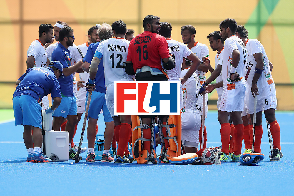 RIO DE JANEIRO, BRAZIL - AUGUST 09:  India huddles up during a break from the hockey game against Argentina on Day 4 of the Rio 2016 Olympic Games at the Olympic Hockey Centre on August 9, 2016 in Rio de Janeiro, Brazil.  (Photo by Christian Petersen/Getty Images)