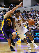 Feb. 21, 2012; Indianapolis, IN, USA; Indiana Pacers shooting guard Paul George (24) dribbles the ball to the lane as he is guarded by New Orleans Hornets point guard Greivis Vasquez (21) at Bankers Life Fieldhouse. Indiana defeated New Orleans 117-108. Mandatory credit: Michael Hickey-US PRESSWIRE