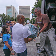 Former New York Yankees All-Star pitcher Mariano Rivera (CENTER) helps volunteers unload a UPS truck full of backpack during a give-away sponsored by &quot;The Mariano Rivera Public Foundation&quot; Monday, August. 14, 2017, at Rodney Square in Wilmington Delaware. <br /> <br /> More than 1,500 backpacks filled with back-to-school supplies was given to children in grades K through 5th grade.