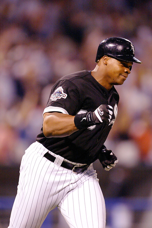 CHICAGO - JULY 25:  Frank Thomas #35 of Chicago White Sox rounds the bases after hitting his 400th career home run against the Tampa Bay Devil Rays in the 5th inning on July 25, 2003 at U.S. Cellular Field in Chicago, Illinois.  (Photo by Ron Vesely)