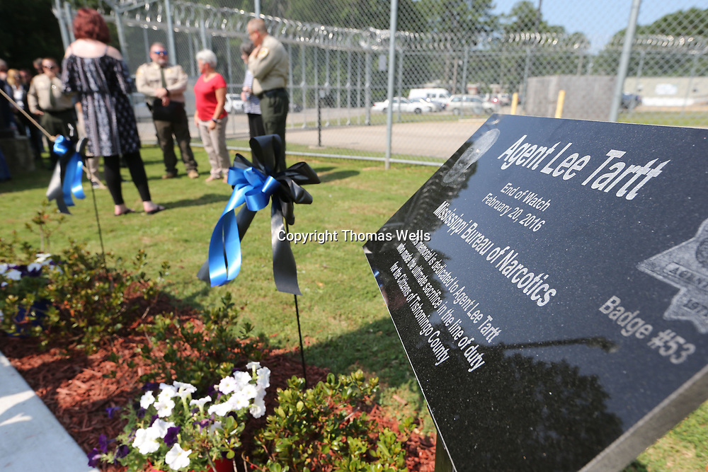 A memorial plaque was unvieled Wednesday at the Tishomingo County Sheriff's Department to honor MBN Officer Lee Tartt who was killed in the line of duty during a 2016 standoff.