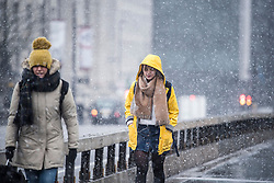 © Licensed to London News Pictures. 17/03/2018. London, UK. Snowfall on Westminster Bridge in central London as a 'Mini Beast' forecast to bring snow and ice the parts of the UK. The drop in temperatures is expected to bring disruption, with flights cancelled at Heathrow airport. . Photo credit: Ben Cawthra/LNP