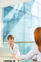 Businesswomen discussing at table in office