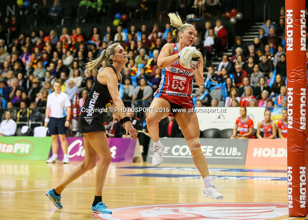 NSW Swift's Caitlin Thwaites takes a pass under pressure from Waikato BOP's Leana De Bruin during the ANZ Netball Championship semi final between the Waikato BOP Magic and the NSW Swifts, played at Claudelands Arena, Hamilton, New Zealand on Monday 25 July 2016.  Copyright Photo: Bruce Lim / www.photosport.nz